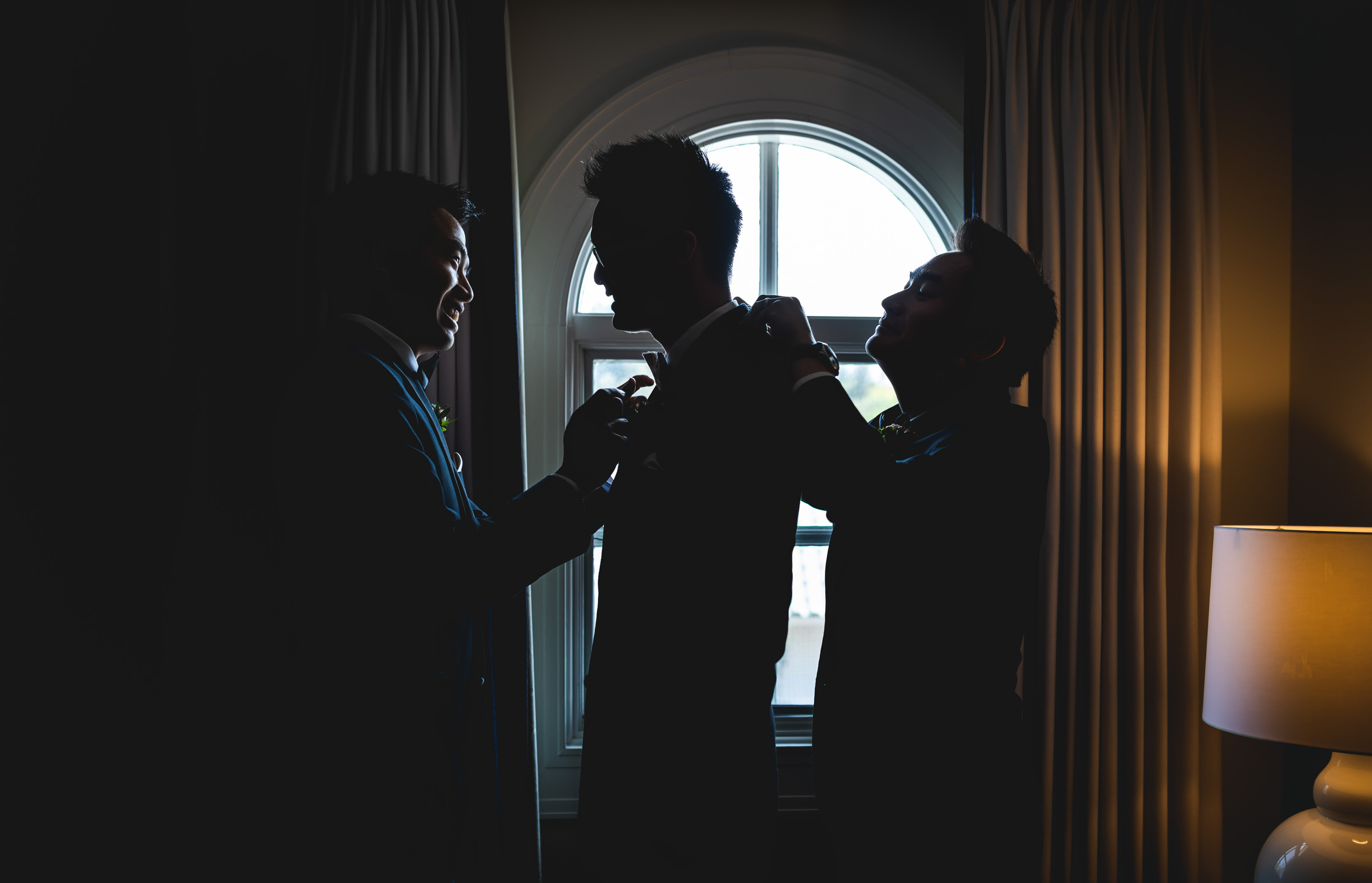 groom getting ready helped by his best friends best man