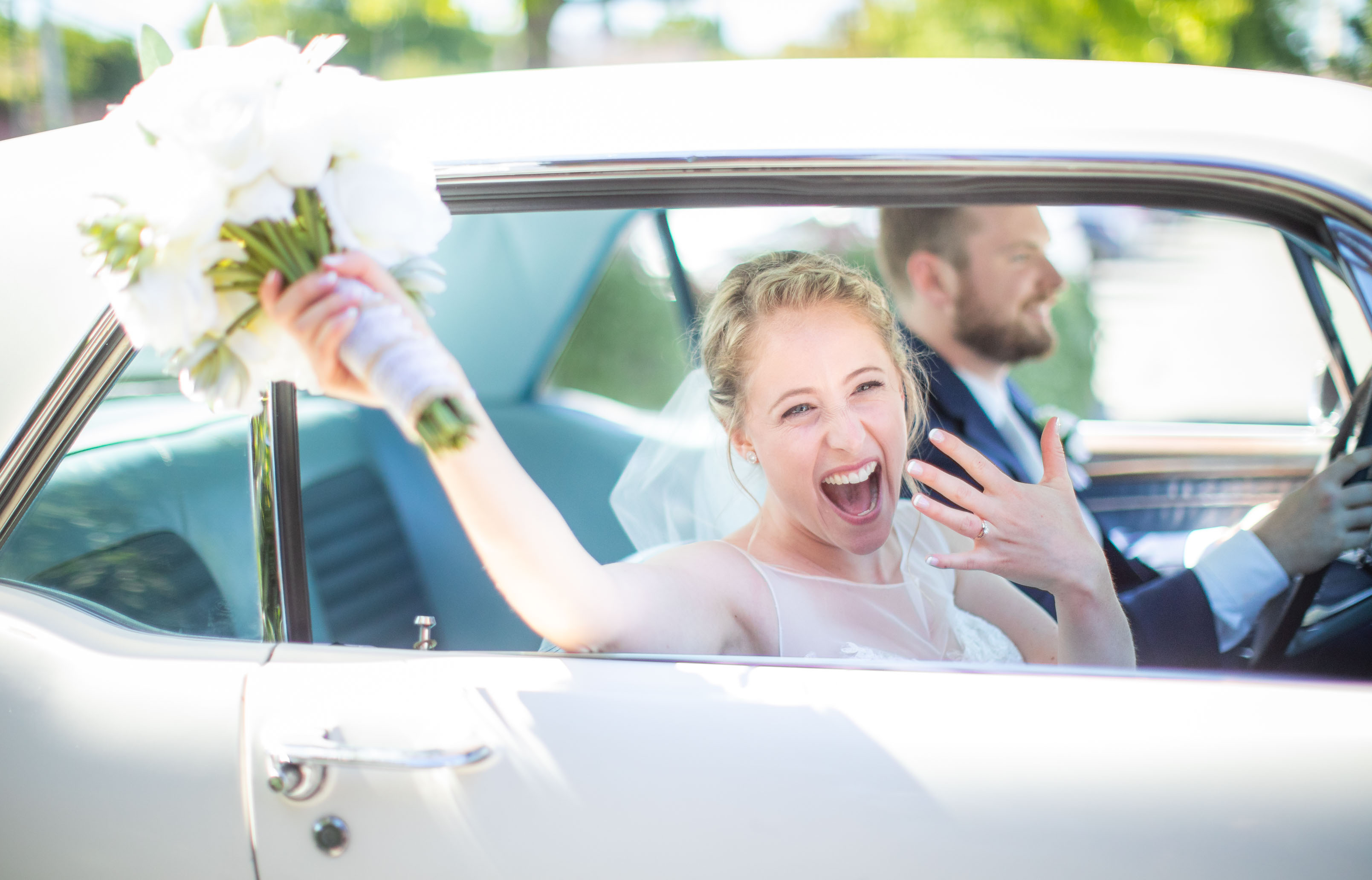 bride in vintage car excited about marriage